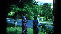 1965: retro filming of kids waiting while classic car drives by HAWAII Stock Footage