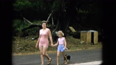 1965: mother walking down mother dog following street scene HAWAII Stock Footage