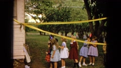 1965: children outdoor in hats at a birthday party HAWAII Stock Footage