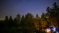 MoCo Pan Astro Timelapse of Moonrise over Forest Campground  Stock Footage