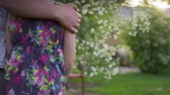 Medium panning shot of boy and girl walking away / Springville, Utah, United Stock Footage