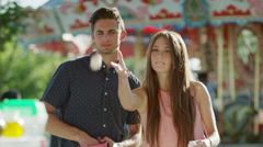 Medium shot of couple playing game at amusement park / Pleasant Grove, Utah, Stock Footage