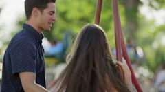 Close up slow motion shot of man spinning woman on swing / Pleasant Grove, Utah, Stock Footage