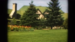 1949: a vast edificacion with green roofs is surrounded by lots of vegetation Stock Footage