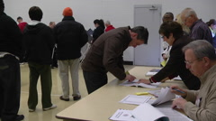 An Ohio voter registers to cast a ballot in the presidential election. Stock Footage