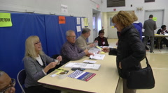 An Ohio voter prepares to cast a ballot in the presidential election. Stock Footage