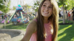 Close up of woman pulling man by arm in amusement park / Pleasant Grove, Utah, Stock Footage