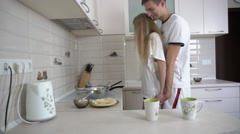 Couple cooking breakfast and making fun in the kitchen Stock Footage