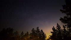 Astro Timelapse of Starry Sky & Moonrise over Forest Campground -Tilt Down- Stock Footage