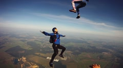 Skydivers make formation in sky. Extreme sport. Adrenaline. Height. Flight Stock Footage