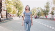 Confident beautiful woman walking in the city, steadicam shot Stock Footage