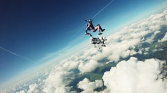 Skydiver freestyle dance in sky. Extreme sport. Adrenaline. Height. Clouds Stock Footage