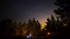 Astro Timelapse of Starry Sky & Moonrise over Forest Campground -Zoom In- Stock Footage