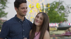Close up of couple posing at amusement park / Pleasant Grove, Utah, United Stock Footage