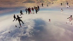 Team of skydivers making big formation in sky. Height. Extreme sport. Speed Stock Footage