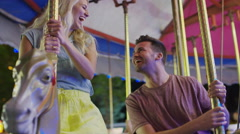 Medium low angle shot of couple kissing on carousel / Pleasant Grove, Utah, Stock Footage