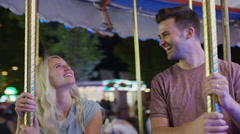 Medium low angle shot of couple talking on carousel / Pleasant Grove, Utah, Stock Footage