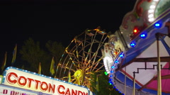 Wide low angle view of amusement park at night / Pleasant Grove, Utah, United Stock Footage