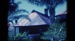 1951: the view of the outdoor of one story shaded house FLORIDA Stock Footage
