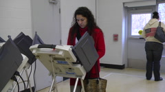 An Ohio voter casts her ballot in the presidential election. Stock Footage