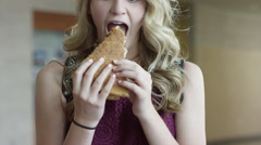 Close up shot of happy woman eating pizza / Mapleton, Utah, United States Stock Footage