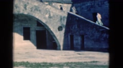 1951: building banner trees brick wall fence white huge water trees FLORIDA Stock Footage