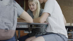 Medium shot of students studying in school cafeteria / Mapleton, Utah, United Stock Footage
