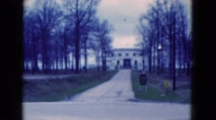 1951: a view of a long driveway with trees on either side Stock Footage