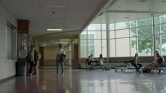 Wide shot of students hanging out in school lobby / Mapleton, Utah, United Stock Footage