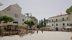 Wide panning shot of people walking in commons / Ravello, Campania, Italy Stock Footage
