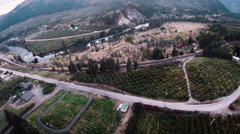 Aerial: Cemetary and Rural Valley Farmland With a River in The Fall Stock Footage