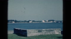 1951: the blue sky over a beautiful lake or river as seen from the shoreline Stock Footage