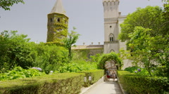Wide shot of couple walking on path toward castle / Ravello, Campania, Italy Stock Footage