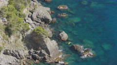 Wide high angle shot of ocean waves on rocks / Laurito, Campania, Italy Stock Footage