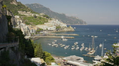 Wide panning shot of boats in harbor / Amalfi, Campania, Italy Stock Footage