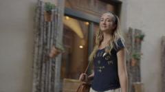 Medium slow motion tracking shot of woman walking on sidewalk / Florence, Stock Footage