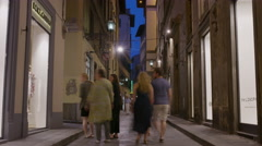 Wide time lapse shot of people on urban street at night / Florence, Tuscany, Stock Footage