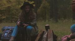 Hikers couple sitting near bonfire. 4K UHD RAW edited footage Stock Footage