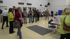 Ohio voters wait in line to bast their ballots in the presidential election. Stock Footage