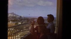 1965: two adult women and a girl watching the landscape from a balcony HAWAII Stock Footage