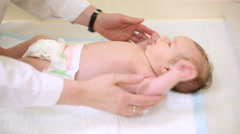 Neurologist checks the reflexes of the baby Stock Footage