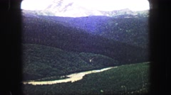 1967: view of a big natural valley and snowy mountains from a high point of view Stock Footage