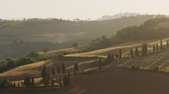 Wide shot of shadows on rolling landscape / Pienza, Tuscany, Italy Stock Footage