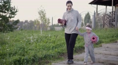 Mother and her daughter going to do exercises Stock Footage