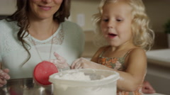 Close up panning shot of mother and daughter measuring flour for baking / Orem, Stock Footage