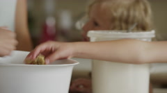 Close up panning shot of mother and daughters rolling cookie dough / Orem, Utah, Stock Footage