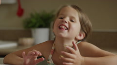 Close up shot of girl licking cookie dough from fingers / Orem, Utah, United Stock Footage