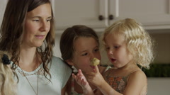 Close up slow motion panning shot of mother and daughters baking cookies / Orem, Stock Footage