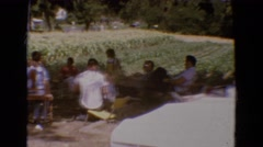 1968: people gathered outdoors at a large family picnic DILLER, NEBRASKA Stock Footage