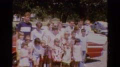 1968: a large group of people congregated to pose on a very sunny day DILLER Stock Footage